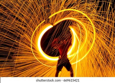 Fire dancers Swing fire dancing show fire show on the beach dance man juggling with fire , Koh Samet, Thailand