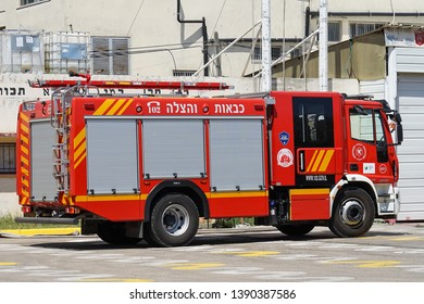 Fire Department. Israeli fire truck with text. Fire engine car. Nobody in the vehicle. 9 May 2018. Tel Aviv. Israel