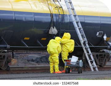 Fire departments and emergency response teams will conduct disaster preparedness drills. These HAZMAT team members are passing tools up to the others on the rail tanker to repair the chemical leak.