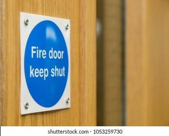 Fire Door Keep Shut Sign on a Wooden Fire Door