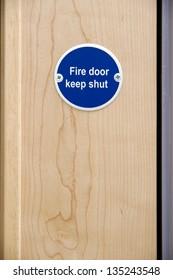 Fire door keep shut sign on an office door
