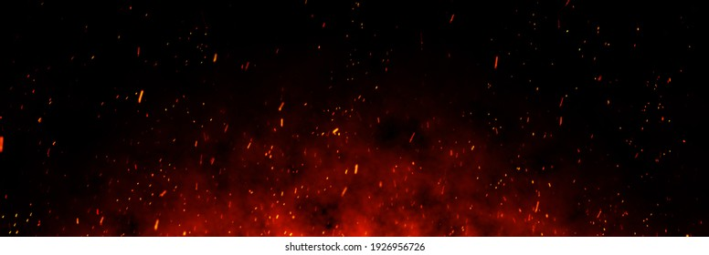 Fire embers particles over black background. Fire sparks background. Abstract dark glitter fire particles lights. bonfire in motion blur.