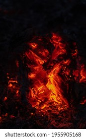 Fire embers particles over black background. Fire sparks background. Abstract dark glitter fire particles lights. Burning lava or dynamic plasma rushing emotionally or falling. Great as design element
