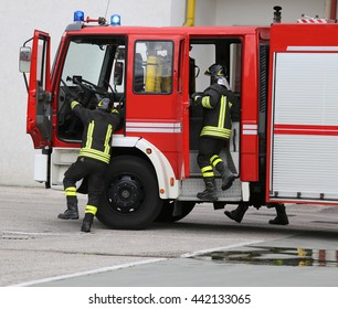 fire engine carrying firefighters and equipment for fighting fire