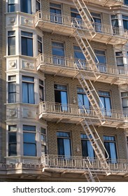 Fire escape ladder zigzagging across the face and windows