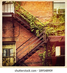 Fire escape on the facade of a red brick building, instagram style
