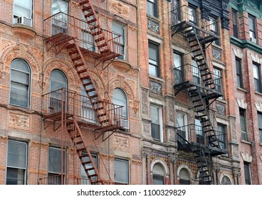 Fire escape and stairs on exterior of walk up apartment building