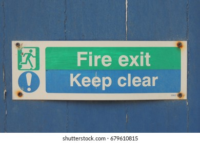 Fire exit Keep clear - a sign on the door of a church in Looe in Cornwall