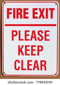 Fire Exit Please Keep Clear Sign on a wall