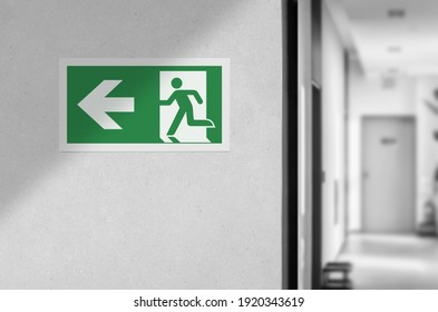 Fire exit sign in the corridor of the building