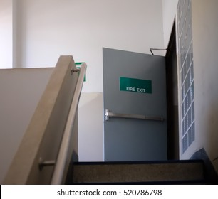 Fire exit sign, stairwell fire escape in a modern building.