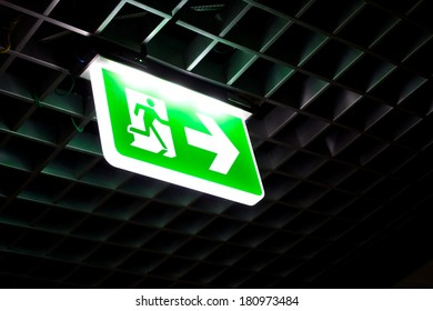Fire exit signs in the building.
