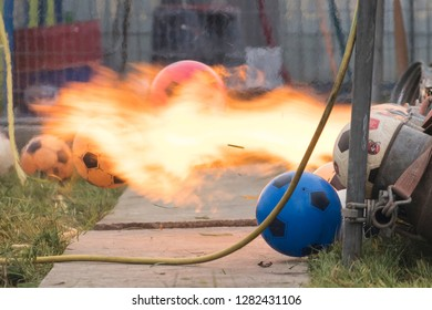 Fire explosion with carbide shooting. launching a ball