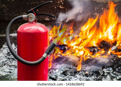 Fire extinguisher and burning flame