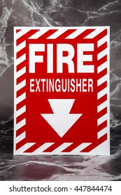 A fire extinguisher directional sign