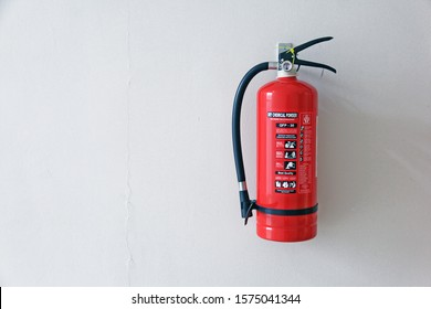 a fire extinguisher on the wall