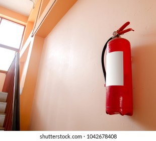fire extinguisher on wall in a building.