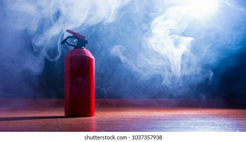 a fire extinguisher stands in a room, it develops strong smoke