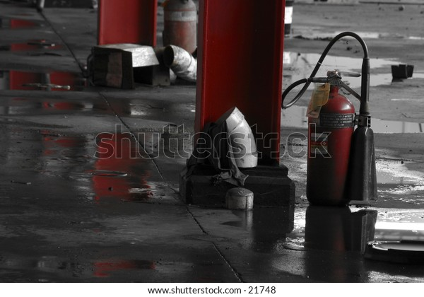 Fire extinguishers in an abandoned factory.