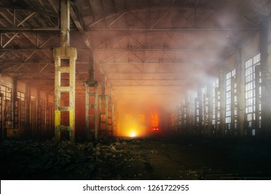 Fire in the factory. Ruined building full of smoke.