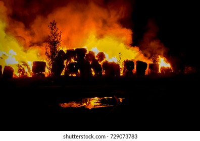 A fire in a farm nearby Monselice (Padova), in nort-eastern Italy and firemen on duty on August 22th, 2000.
