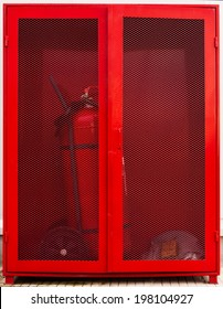 Fire fighter equipment in the red box with extinguisher