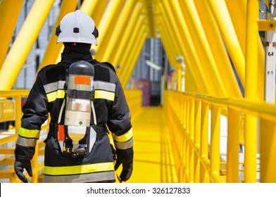 Fire fighter on oil and gas industry, successful firefighter at work , Fire suit for fighter with fire and suit for protect fire fighter, Security team when fire case.