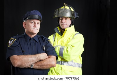 Fire fighter and police officer on black background with copyspace.