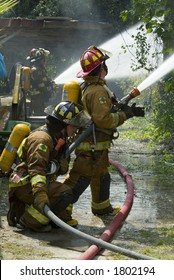 Fire fighters beat down deadly flames