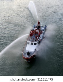Fire fighting boat sprays water on river