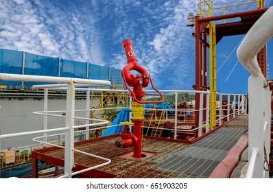 fire fighting foam,water gun, fire hydrant on board of tanker ship on blue sky background