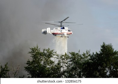 fire fighting helicopters drops water on the fire