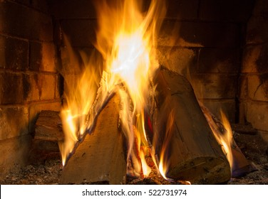 Fire in fireplace. Fire background. Blazing Bonfire. Firewood burns in a fireplace.