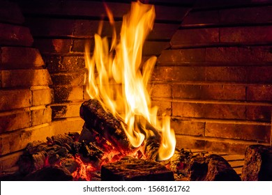 Fire in a fireplace. Burning wood.