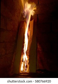 Fire in the fireplace. Couple of logs lighted up to keep the house warm