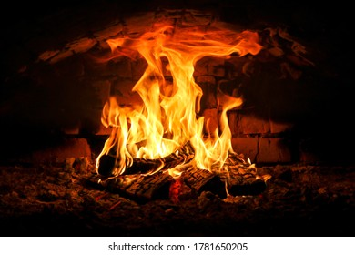 The fire in a fireplace. Fire crackling in the fireplace; country house atmoshpere.