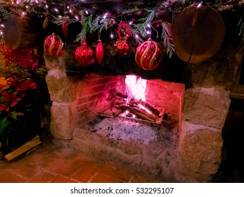 Fire in a fireplace decorated for Christmas. Christmas fireplace,