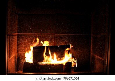 Fire in the fireplace at the midnight