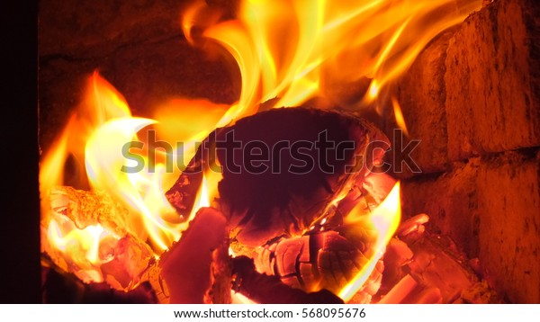 Fire in fireplace. Soft focus background