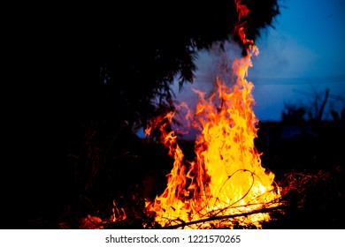 Fire and flames with a burning dark red-orange background.