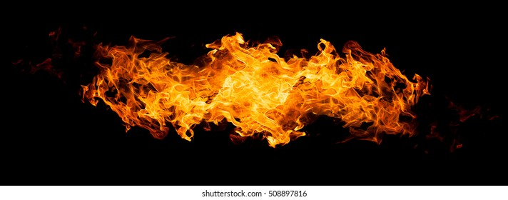 Fire flames - isolated on black background. Real photo