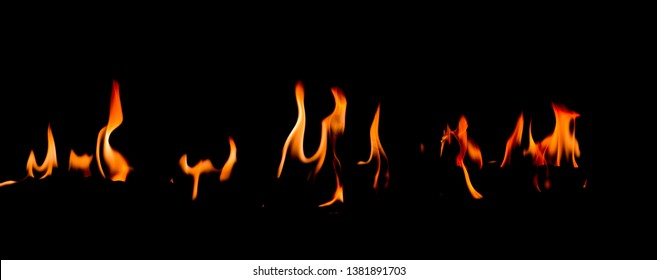 Fire flames on Abstract art black background, Burning red hot sparks rise, Fiery orange glowing flying particles
