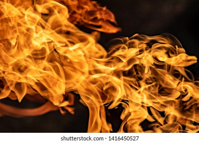 Fire flames on black background, abstract blaze.