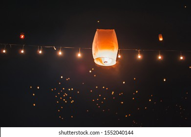 Fire, floating lanterns, wiring in Loi Krathong Day