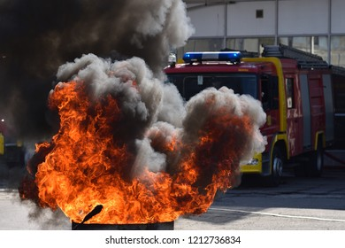 Fire in front of fire truck during demonstrative exercise of firemen skills