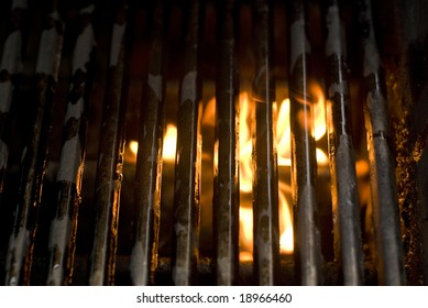 A fire in the grill on a cloudy day.