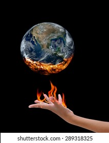Fire in hand and earth ,Elements of image are furnished by NASA