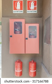 Fire hazards with two extinguishers and two buckets of sand.sign .Traslation sign : ESTINTORE = fire extinguisher , two buckets : SABBIA ANTINCENDIO =sand firefighting