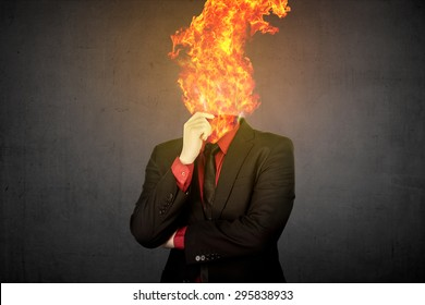 Fire head business man over grunge background