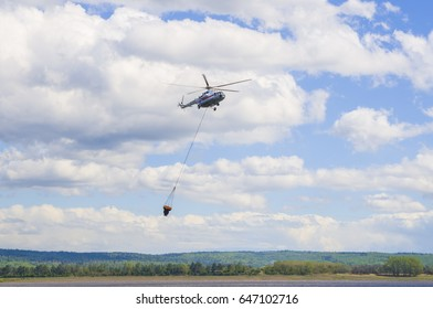 Fire helicopter extinguishes a forest fire